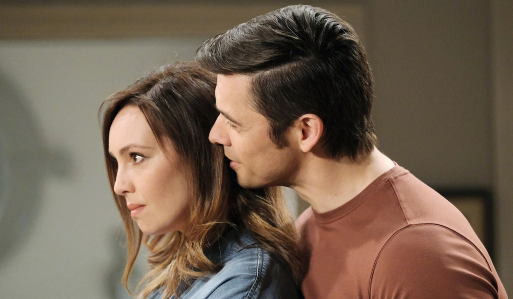 Xander whisphers in Gwen's ear on Days of Our Lives