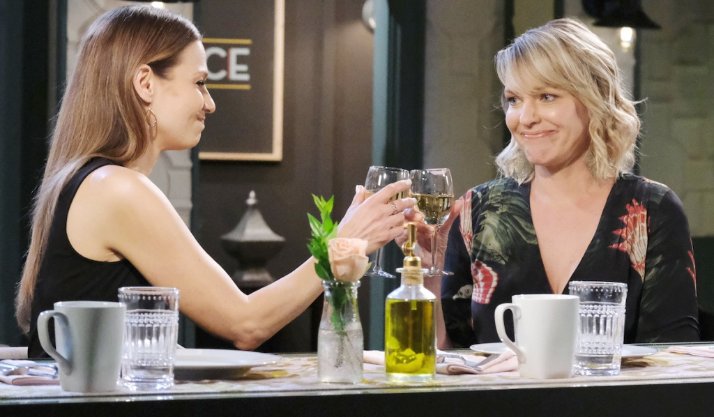 Ava and Nicole toast with wine at Julie's Place on Days of Our Lives