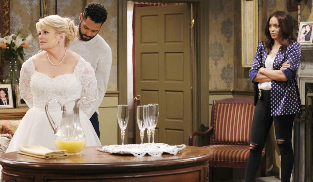 Lani watches as Eli arrests Bonnie in her wedding dress on Days of Our Lives