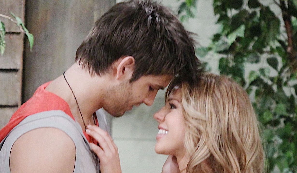 Chad and Abigail lean in close, smiling, on Days of Our Lives