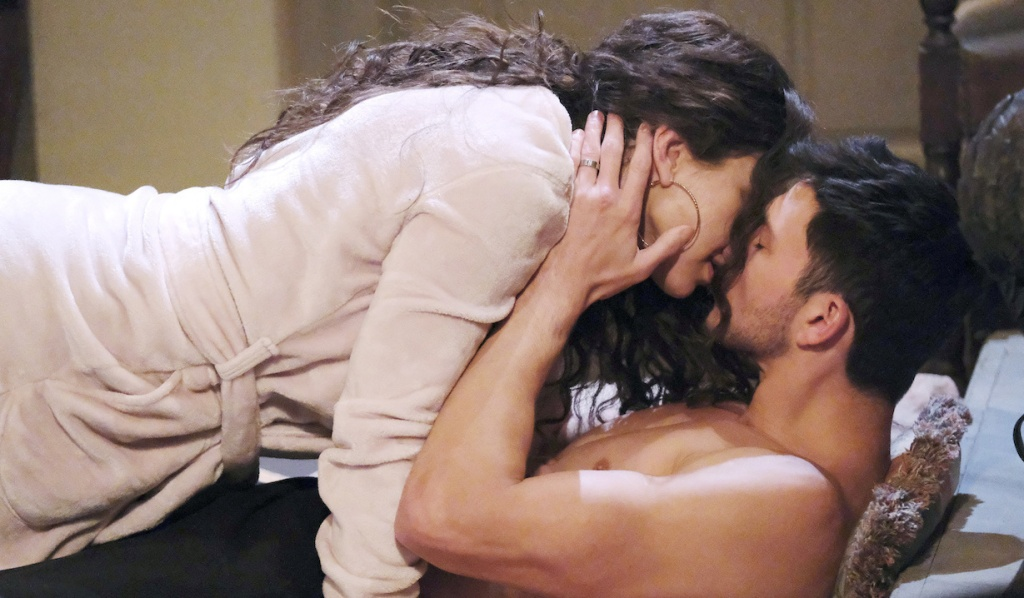 A robed Ciara hovers over a shirtless Ben who holds her face and kisses her on Days of Our Lives