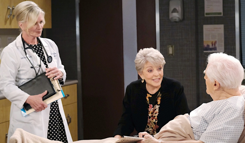 Kayla meets with Doug and Julie at the hospital on Days of Our Lives
