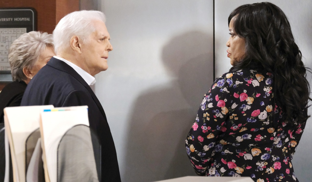 Doug looks at Paulina at the hospital elevators on Days of Our Lives