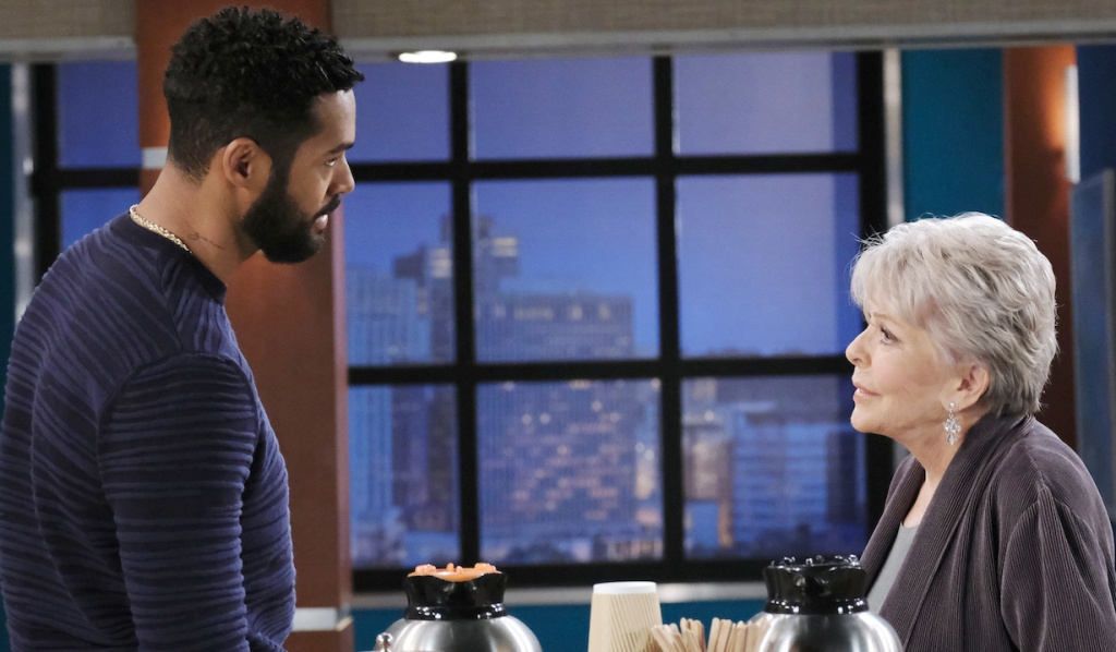 Eli and Julie face each other in the hospital lobby area on Days of Our Lives