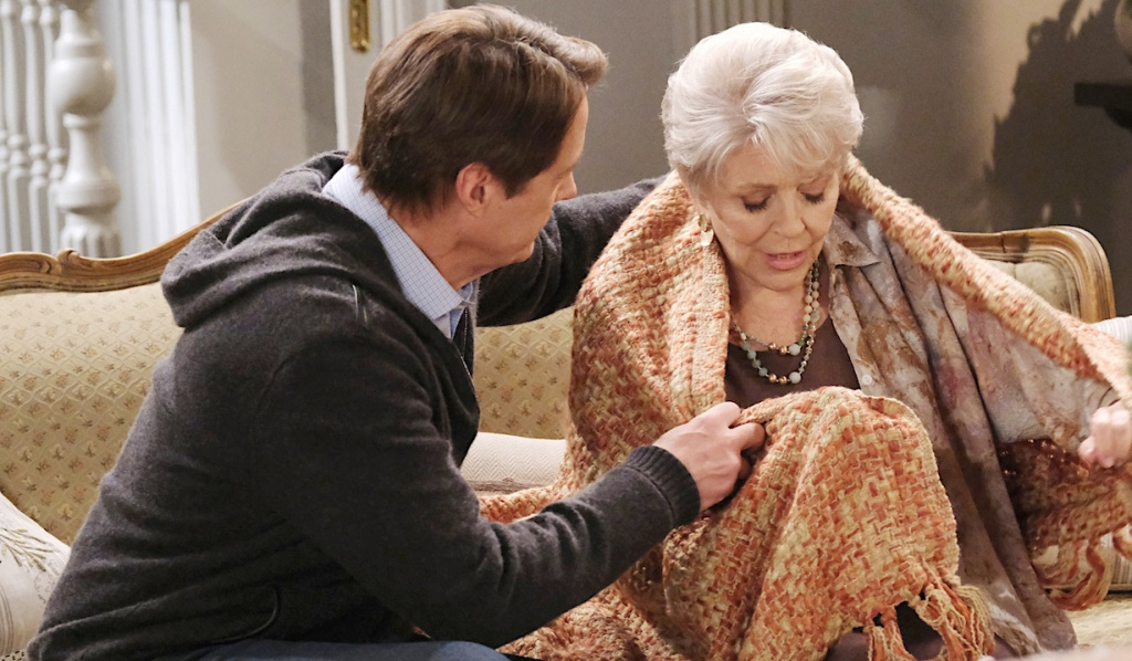 Jack tends to Julie wrapped in a blanket on Days of Our Lives
