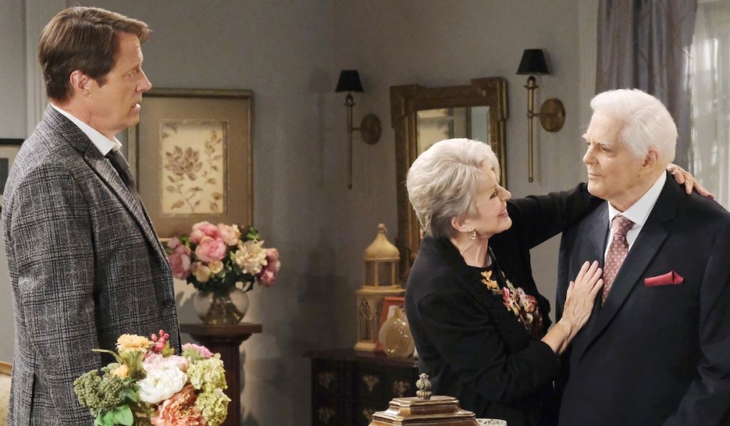 Jack watches as Julie fawns over Doug at the Horton House on Days of Our Lives