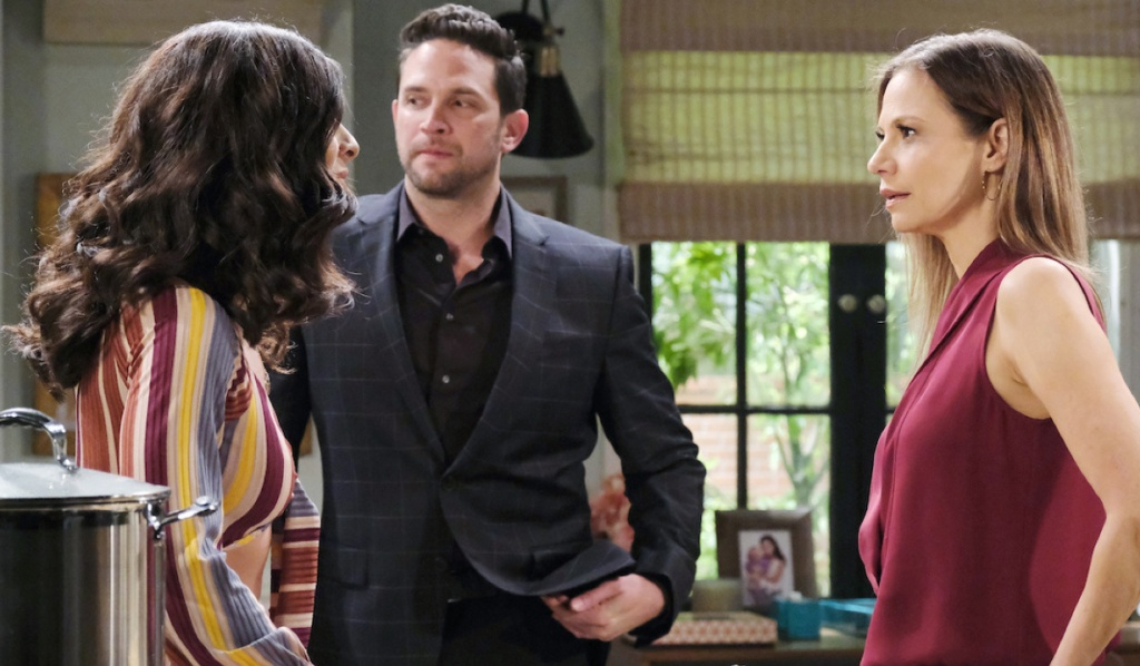 Jake averts his eyes as Gabi and Ava face off in Rafe's kitchen on Days of Our Lives