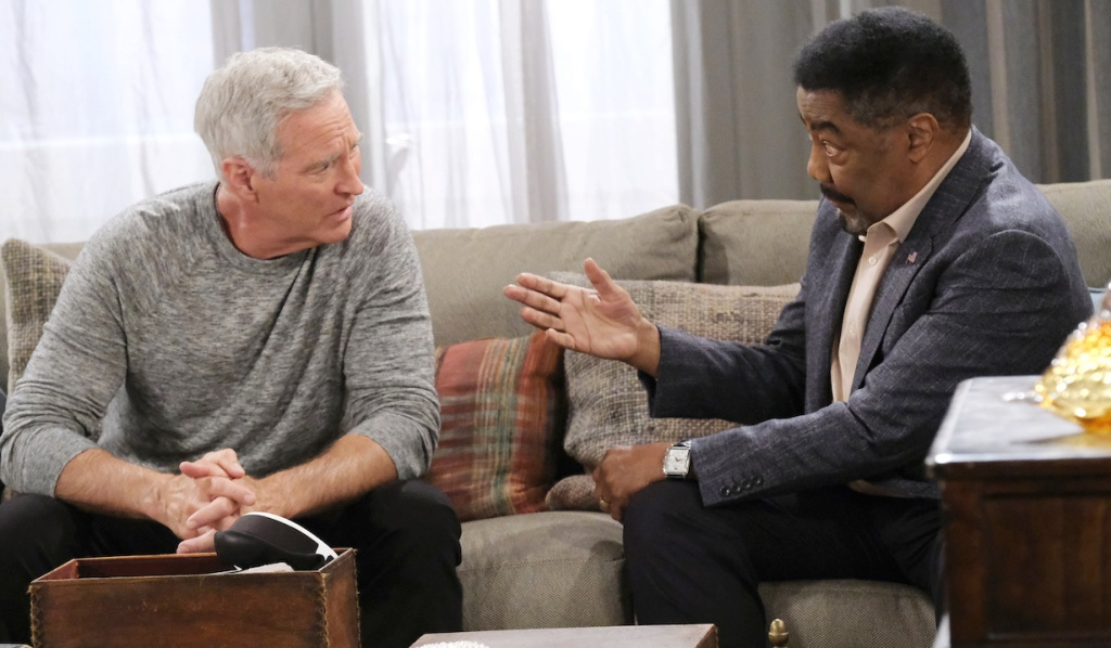Abe talks with John on the penthouse couch on Days of Our Lives