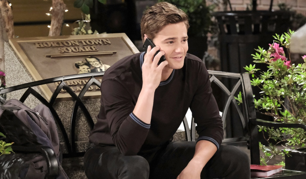 Johnny makes a call from the bench in Horton Square on Days of Our Lives
