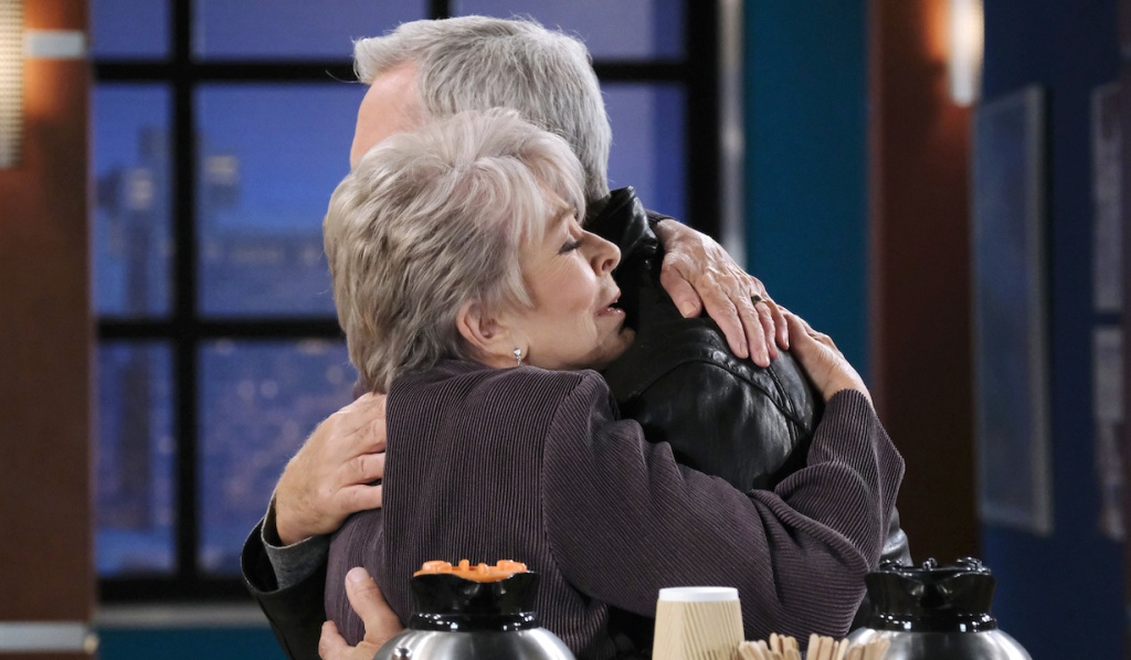 Julie clings to John in an embrace at the hospital on Days of Our Lives