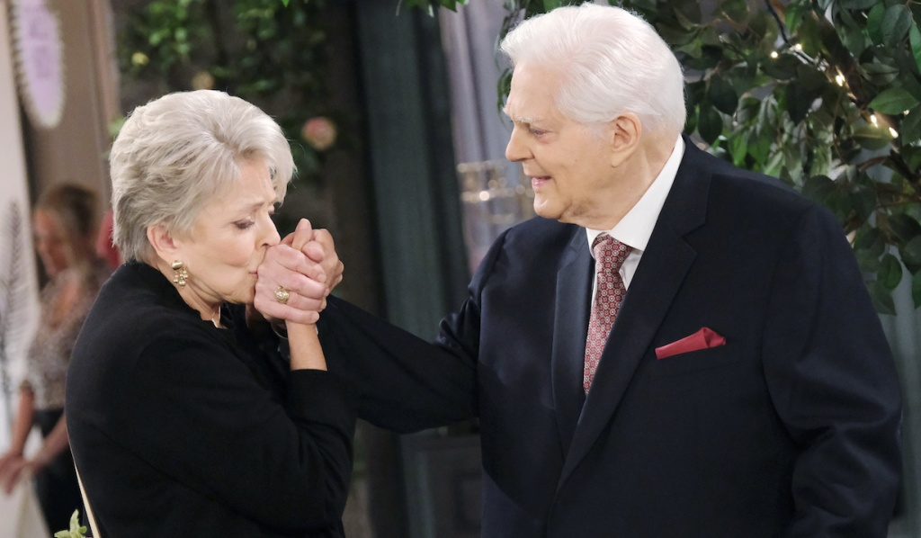Julie kisses the back of Doug's hand on Days of Our Lives