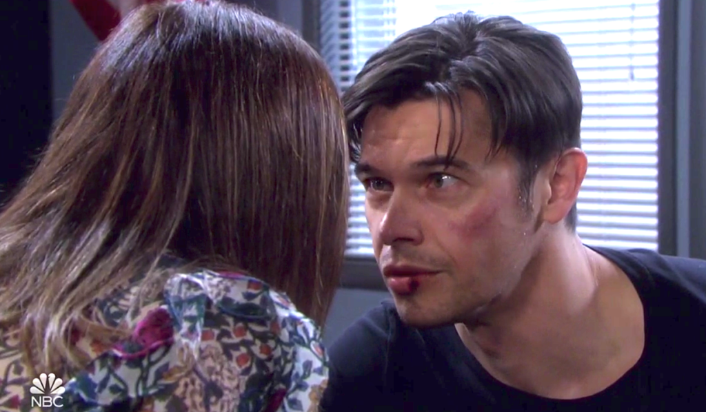 Xander's eyes widen as he talks close to Gwen in the interrogation room on Days of Our Lives