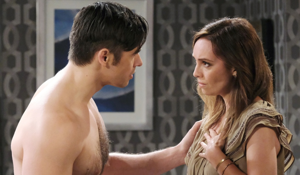 A shirtless Xander leans in close to Gwen at the Salem Inn on Days of Our Lives