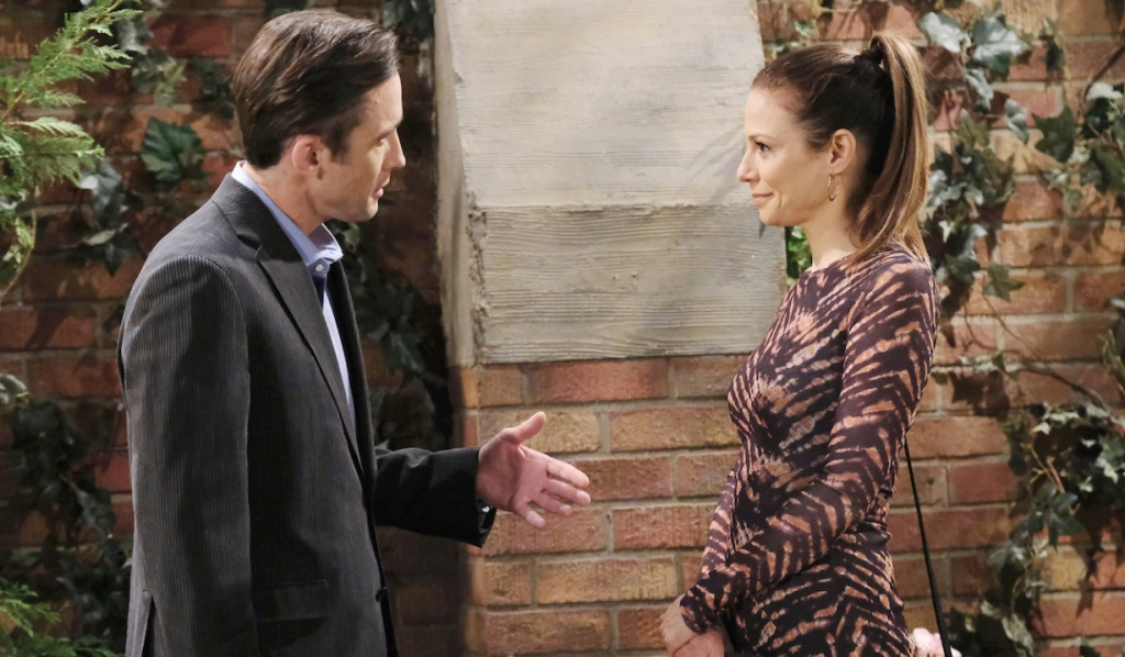 Ava smirks at Philip who makes an emphatic point in the park on Days of Our Lives