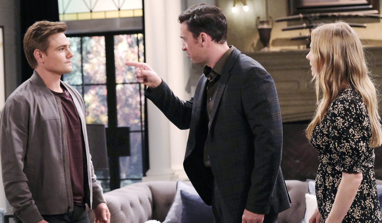 Chad angrily points his finger at Johnny as Abigail watching in the DiMera living room