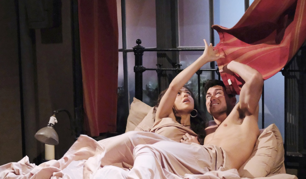 Ben and Ciara shield themselves from billowing curtains in bed on Days of Our Lives