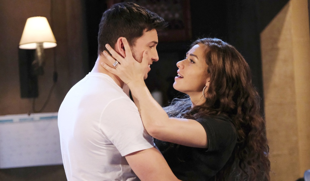 Ciara holds Ben's face as they smile on Days of Our Lives
