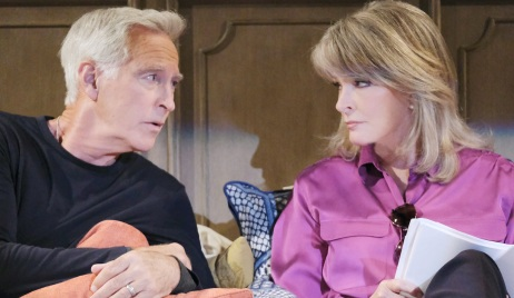 John and Marlena glare at each other while sitting up in bed on Days of Our Lives