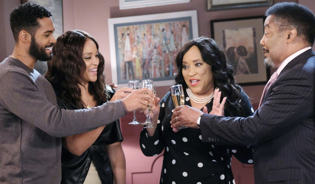 Eli, Lani, Paulina and Abe stand in a semi circle, toasting with champagne on Days of Our Lives.