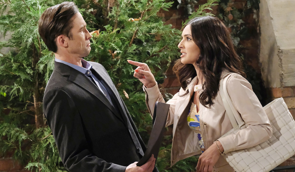 Philip leans back with a frown as Gabi angrily points her finger at him on Days of Our Lives