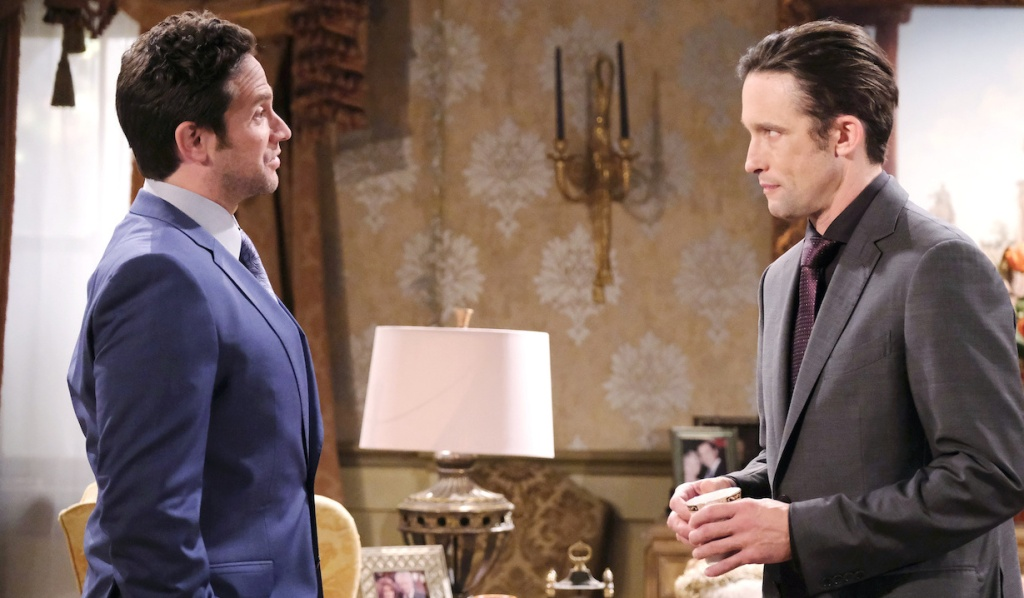 Philip glowers as Johnny talks to him at the Kiriakis mansion on Days of Our Lives