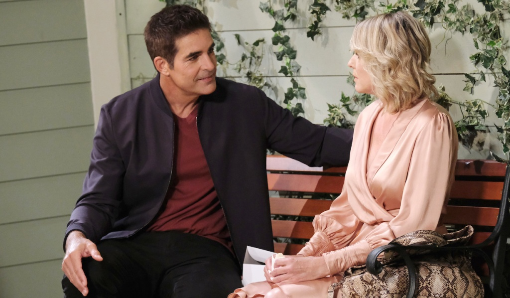 Rafe and Nicole talk on the bench outside Brady's Pub on Days of Our Lives